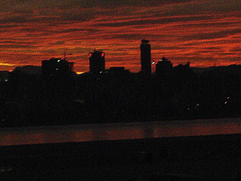 Red sky and the city skyline
